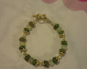 fire green turquoise, olive jade, swarovski green crystal, and prehnite bracelet with gold filled toggle and vermeil bead caps