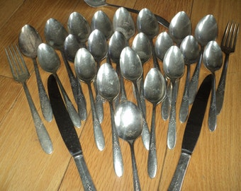 29 pieces of  silver-plated stamped flatware utensils  with the Tudor Plate Oneida Community maker's mark with well developed patina