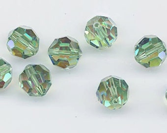 Twelve Swarovski crystals: art 5000 - 8 mm - erinite AB