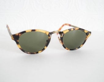 Vintage Oliver Peoples Sunglasses Oval Tortoise Frame Brass Filigree Detail