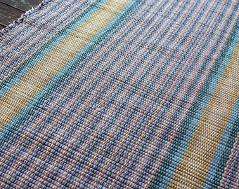 Handwoven cotton rug in gray, yellow and teal