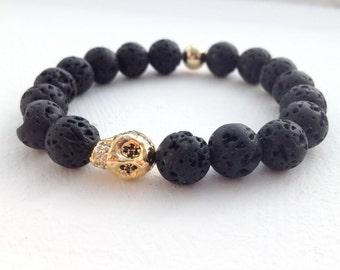 Lava stone bracelet with golden skull