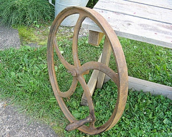 Curved spoke flywheel