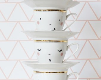 set 4  hand-printed happy faces cups