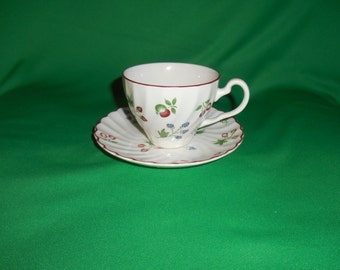 """One (1), 2 3/4"""" Flat Cup & Saucer, from Johnson Bros., in the Sweetbriar Pattern."""