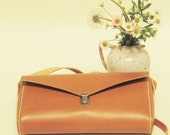 100 % handmade, handstitched   light brown,orange brown leather  bag, by GENATI.