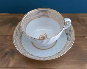 Antique Coalport Shanked Fluted Tea Cup and Saucer c1810