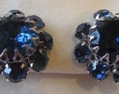 Vintage silver tone clip on earrings with blue rhinestones