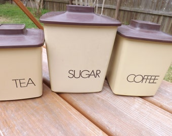 Set  of three plastic canisters - beige - brown plain lettering