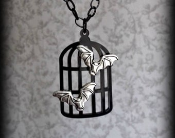 Gothic pet bat birdcage necklace.