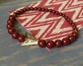 beaded stretch bracelet, maroon, dark red, garnet, stretchy bracelet, swarovski, crystal, gold arrow accent bead