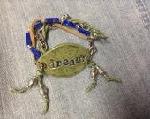 Yoga inspired boho motivational dream bracelet ceramic pottery wrap bracelet earthy sage greens and lapis lazuli beads