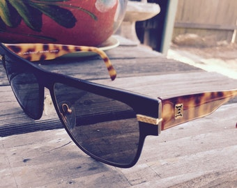 Laura Biagiotti vintage sunglasses, Made in Italy, black, gold tone and brown mock tortoiseshell, large, 1980's era