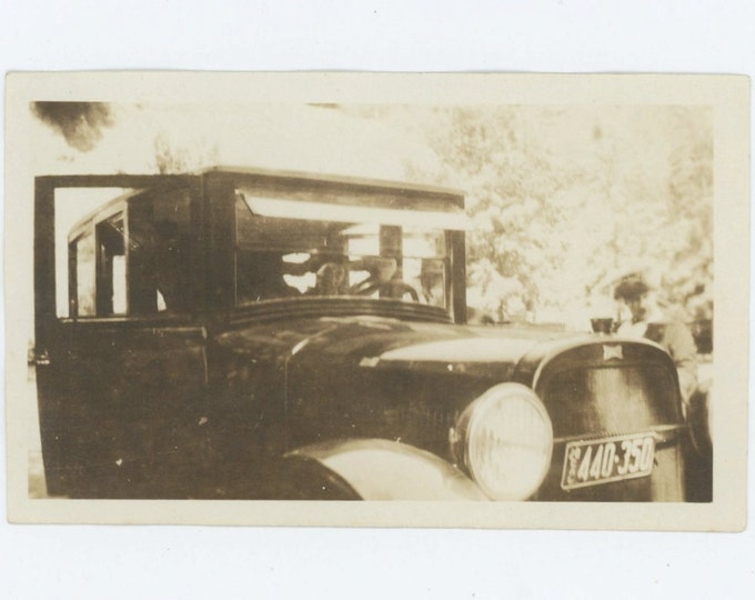 Woman Fixes Hair in Front of Car, c1920: Vintage Snapshot Photo (68491)