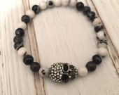 Black and white zebra jasper beaded bracelet with pave rhinestone skull bead