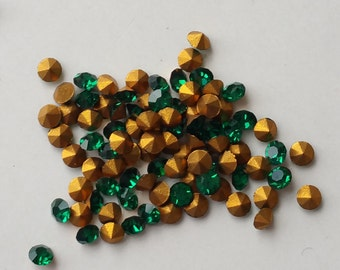 50 Swarovski Emerald Green chatons with gold foil.  2.4-2.5mm 18pp