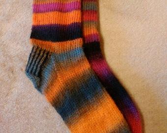 Tangerine dream, pink and orange stripey handknitted socks