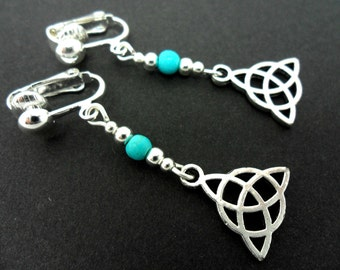 A pair of tibetan silver & turquoise bead celtic knot dangly clip on earrings. new.