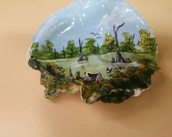Hand painted  oyster shell with a swamp scene.
