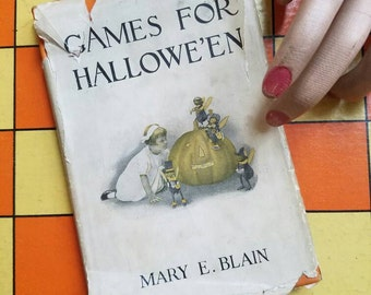 Games for Halloween antique book, 1912, by Mary E. Blain, orange harcover with illustrated dust jacket - jack-o-lantern - spooky fall decor