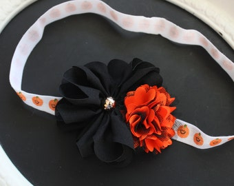HALLOWEEN Black Chiffon Flower with Gold Bead Center and Orange Satin and Black Lace Puff on Jack-O-Lantern Print White Elastic Headband