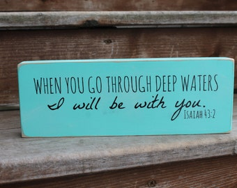 "Isaiah 43:2, ""When you go through deep waters, I will be with you."""