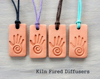 Reiki Hand, Healers Hand Essential oil diffuser Necklace pendant Aromatherapy Kiln Fired Clay Hypoallergenic Mens jewelry Cord Color Option