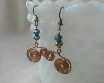 Hammered copper swirls