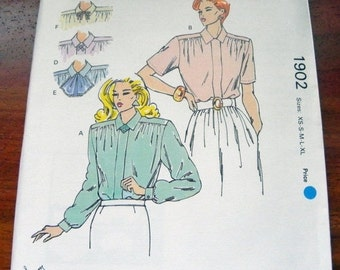 """SALE 1980s Blouse with collar variations sewing pattern Kwik Sew 1902.  Size XS-S-M-L-Xl Bust 31.5-32.5-34-35.5-37-38-40-41.5-43-45"""" Uncut"""