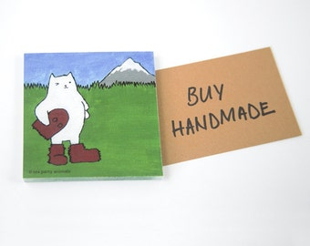 "STICKY NOTEPAD: ""Oregon Cat"", featuring a winking cat in a Sasquatch or Bigfoot Costume in front of Mt. Hood"