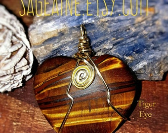 SageAine: Tiger's Eye Heart Pendant, Wolf Stone, Stone of Good Fortune, Defends against curses, Reiki Charged, Crystal Healing