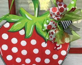 I love this strawberry on my red door!