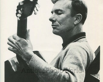 Folk singer Pete Seeger with guitar vintage photo