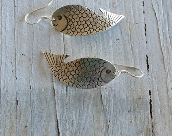 One fish Two fish. Two fine silver fish suspended from fine silver earwires by LadeDAH! Jewelry.