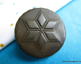 """0092 - Six-Pointed Star Motif on Brown Antique Rubber Button, Backmark """"May 6, 1851, Goodyear's P.T. , N.R. Co."""""""