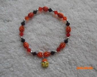 LI'L ORANGE LADYBUG Beaded Bracelet