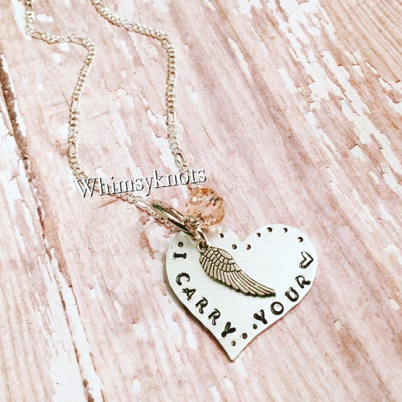I carry your heart necklace /Remberance necklace  / angel wing -personalized and hand stamped.
