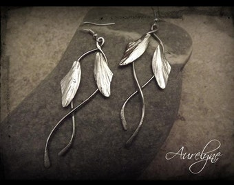 "Earrings Tale ""The Blue Bird"" bamboo leaves or feathers and interlacing ties 925"