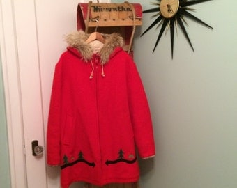Bright red Hudson's Bay wool winter jacket - northern scene