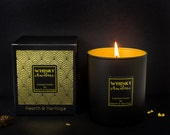 Whisky & Chocolate Scented Candle in luxury matt black glass with gold interior.