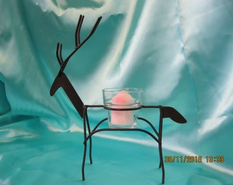 Metal frame Reindeer candle holder with votive cup and candle used