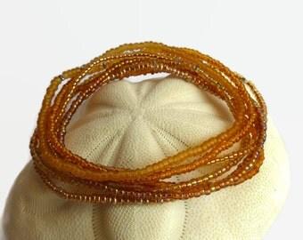 7 amber seed bead bracelets, stretch bracelet, copper, gold, brown, stack bracelet, boho chic,  bracelet set