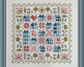 Patchwork Houses – counted cross stitch chart to work in 9 colours of DMC thread. Traditional style patchwork houses and motifs are used.