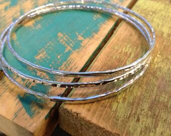 Sterling silver skinny bangle trio set.  Hammered / textered shiny stacking bracelets Set of 3