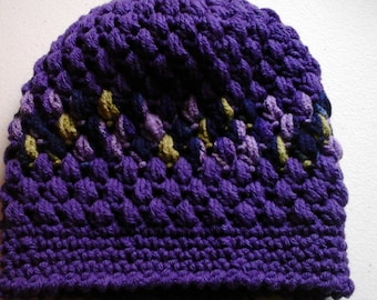 Shades of purple, with lime and blue slouch hat