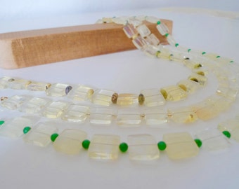 Handmade, delicate and elegant necklace. Acrylic and semi precious stones.