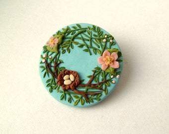 Springtime Nest and Flowers Brooch by Raquel at theWRC pin hand sculpted from polymer clay