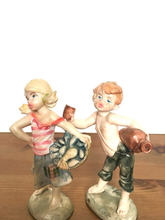 Vintage Italy Depose Fontanini plastic figurines girl and boy children