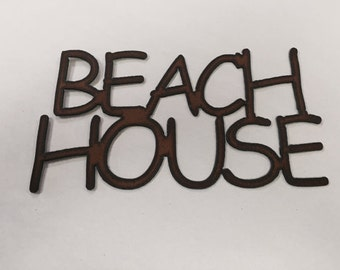 Beach House sign made out of rusted metal