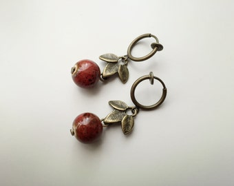 Earrings CLIPS, red ceramic beads, sheets of metal bronze